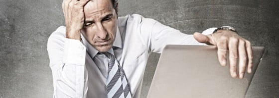 desperate senior businessman in crisis working office computer