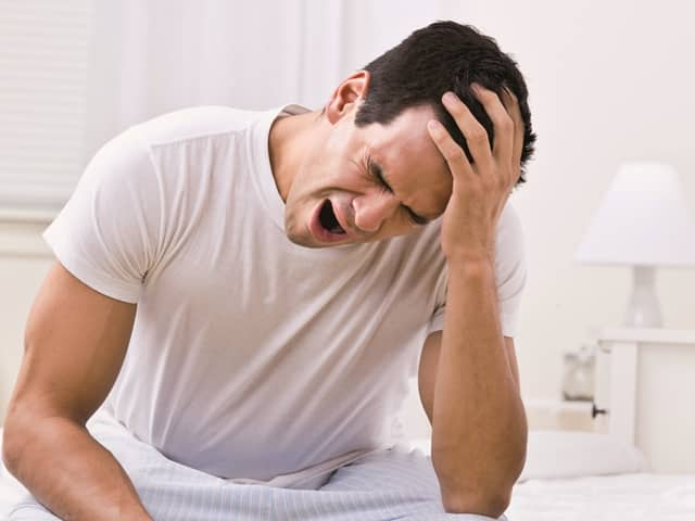 Attractive Man Yawning and Looking Sleepy